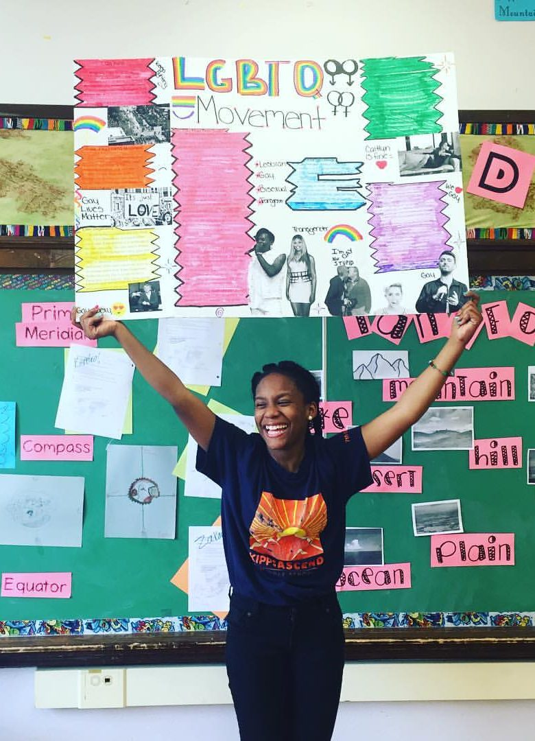 Student with Social justice Fair exhibit on LGBTQ movements